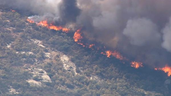 A large brush fire burns in Aguanga, just east of Temecula, on Tuesday, Aug. 14, 2012. Several homes were evacuated and some structures were damaged.