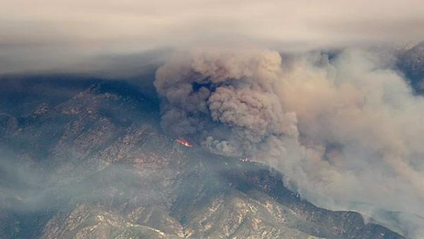 A wildfire raging in the San Gabriel Moun