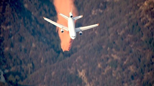 An air tanker makes a drop over a wildfire in the San Gabriel Mountains above Glendora on Sunday, Sept. 2