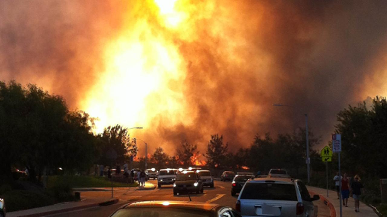 A brush fire that started in Warm Springs Creek and moved through Murrieta on Sunday damaged structures and threatened homes on Sunday, Sept. 23, 2012. <span class=meta>(ABC7 viewer Allison Will)</span>