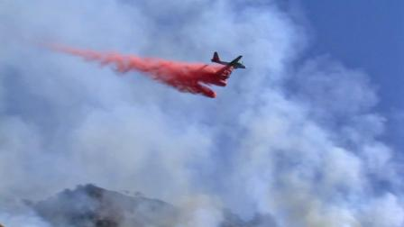 A plane drops flame retardant over a fire that broke out in the Painted Cave area above Santa Barbara on Wednesday, Oct. 17, 2012.