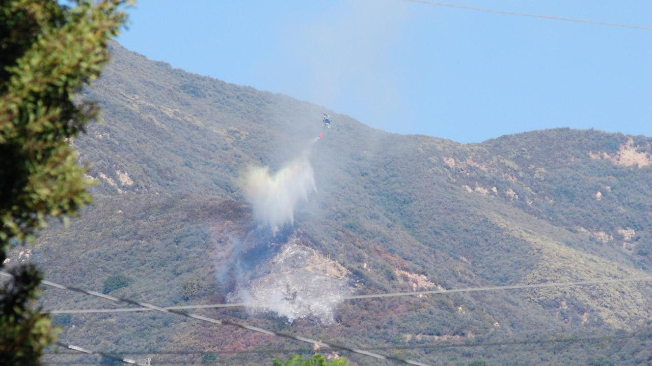 An aircraft makes a waterdrop on a brush fire that erupted in the foothills above Montecito on Tuesday, Nov. 6, 2012.