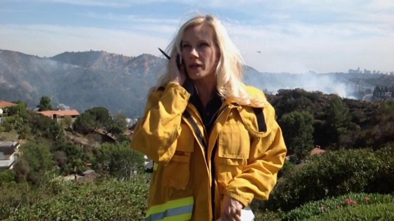 ABC7 reporter Melissa MacBride gets ready to report on a brush fire that erupted in Glendale near the 134 Freeway and Harvey Drive on Friday, May 3, 2013.