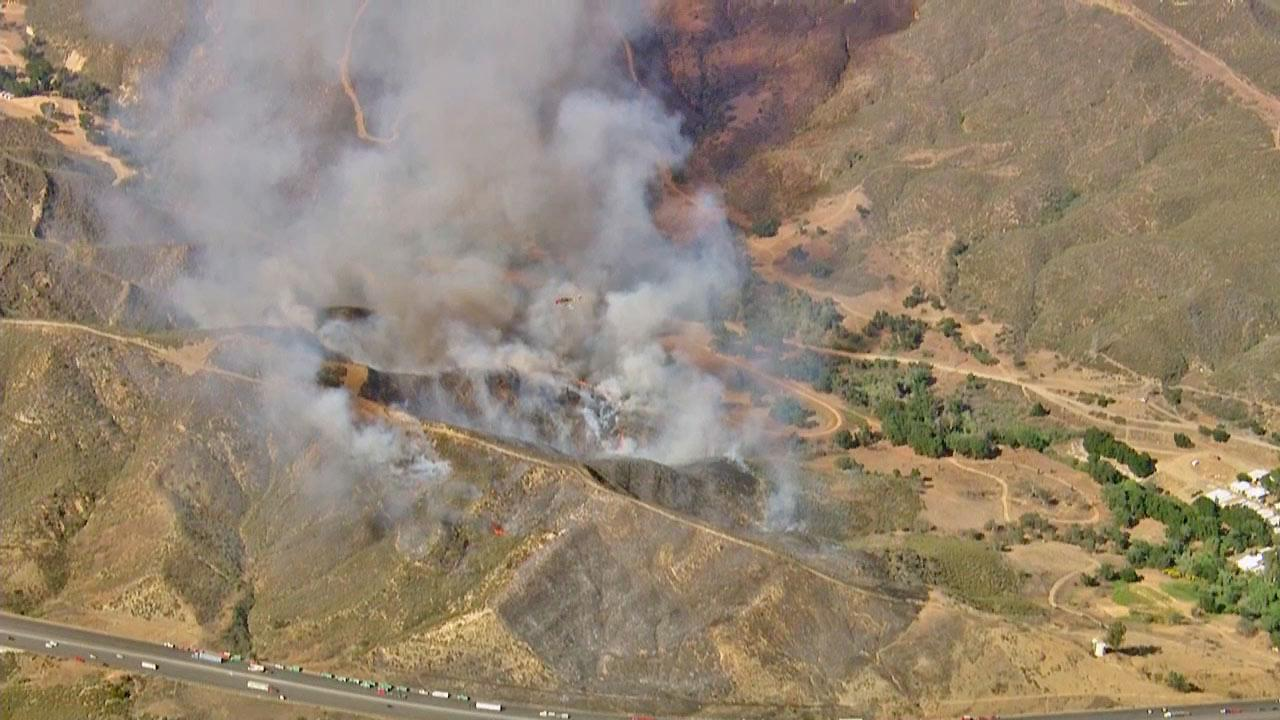 A brush fire burning approximately 10 miles north of Castaic Lake next to the 5 Freeway prompted lane closures Monday, May 13, 2013.