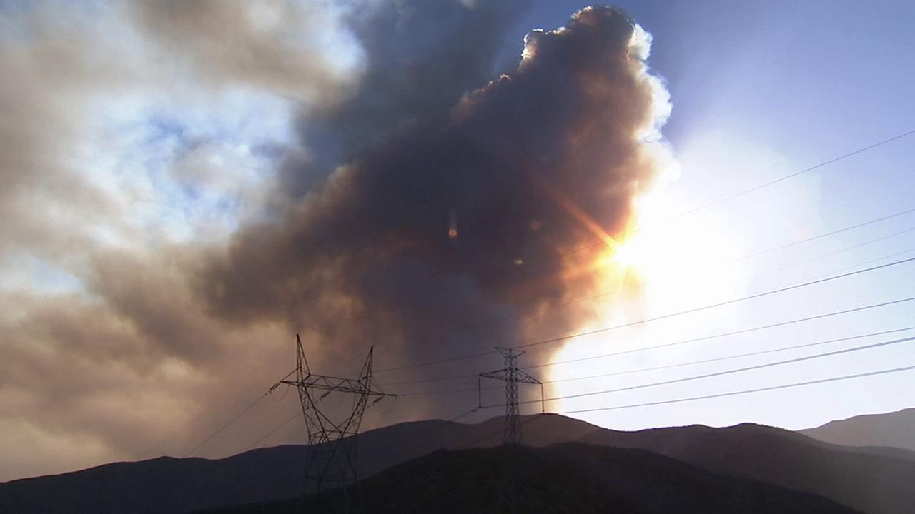 Smoke rises from the Powerhouse Fire, which broke out north of Santa Clarita, along San Francisquito Canyon Road on Thursday, May 30, 2013.