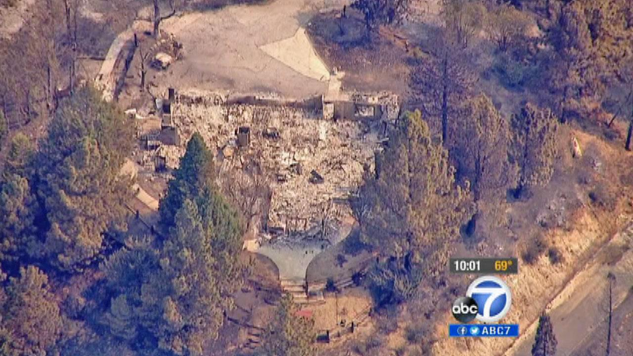 The property where a home once stood is seen after the home was destroyed in the Powerhouse Fire, which continued to burn in the Angeles National Forest north of Santa Clarita on Sunday, June 2, 2013.