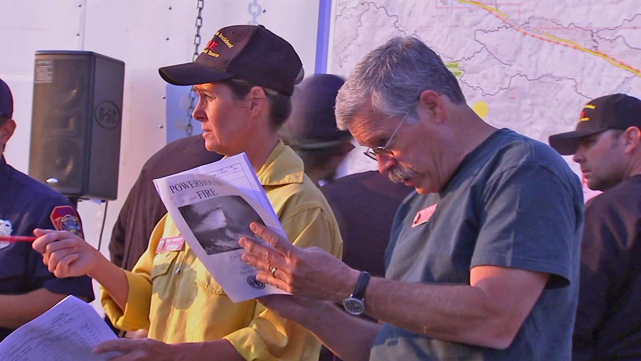 Fire crews discuss plans to battle the Powerhouse Fire on Sunday, June 2, 2013.