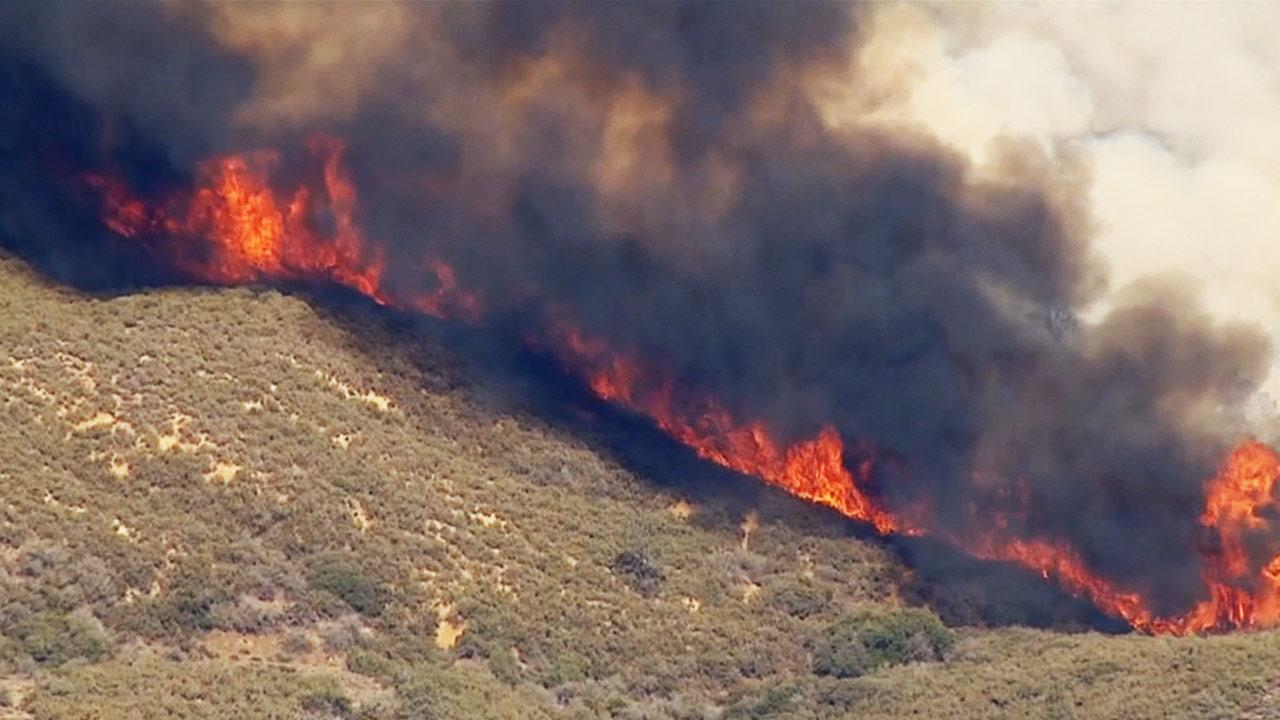 The Powerhouse Fire continued to burn in the Angeles National Forest north of Santa Clarita on Monday, June 3, 2013.