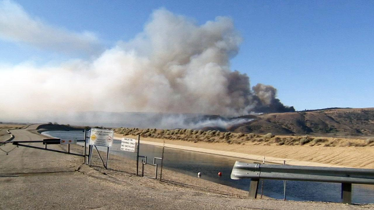 The Powerhouse Fire can be seen from a nearby canal north of Santa Clarita on Monday, June 3, 2013.