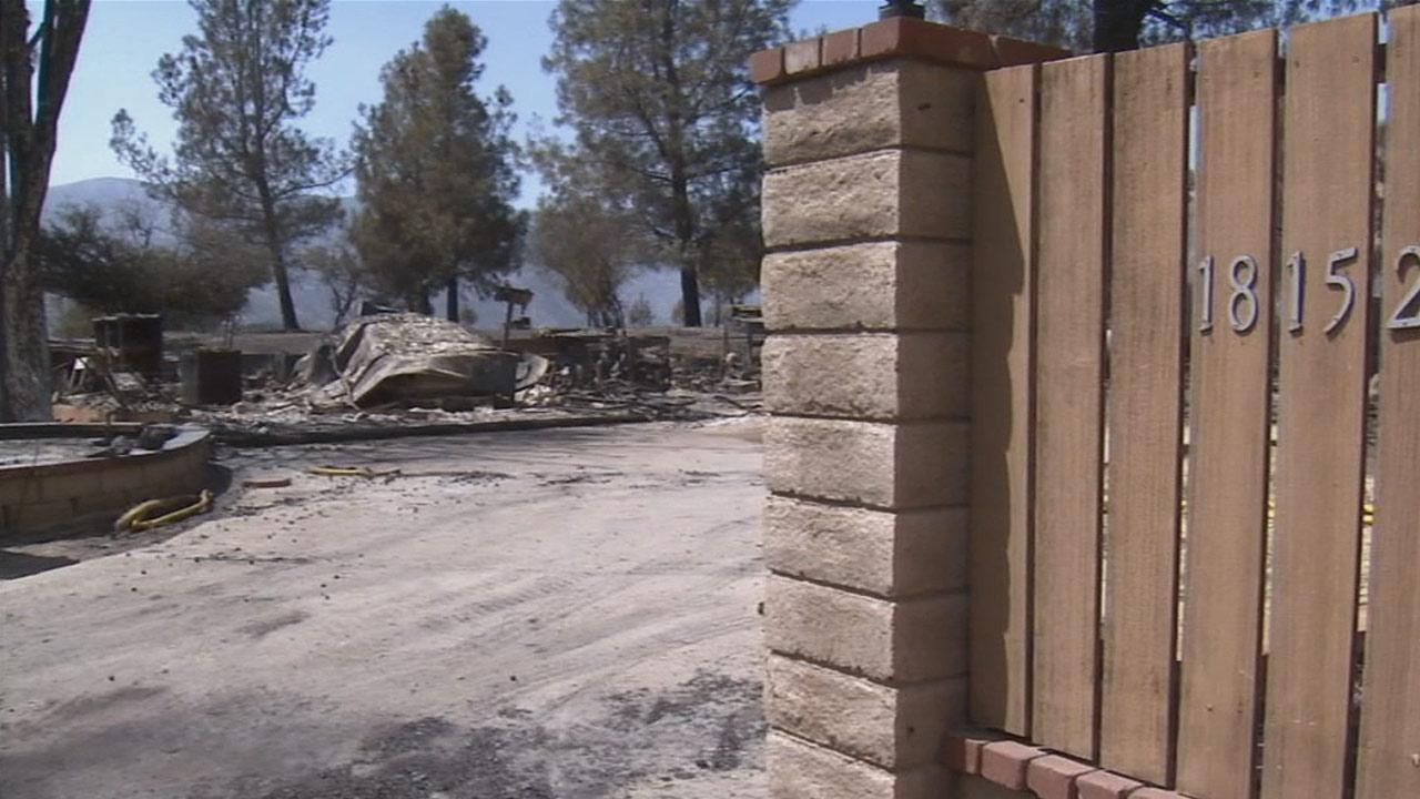 The remains of a residence destroyed by the Powerhouse Fire. The fire continued to burn in the Angeles National Forest north of Santa Clarita on Monday, June 3, 2013.