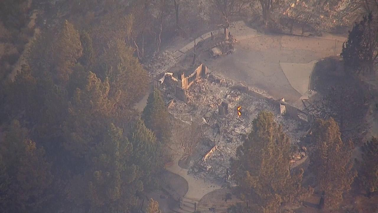 The remains of a structure destroyed by the Powerhouse Fire is seen by AIR7 HD.