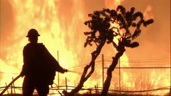 A firefighter battles a wildfire in this undated file photo.