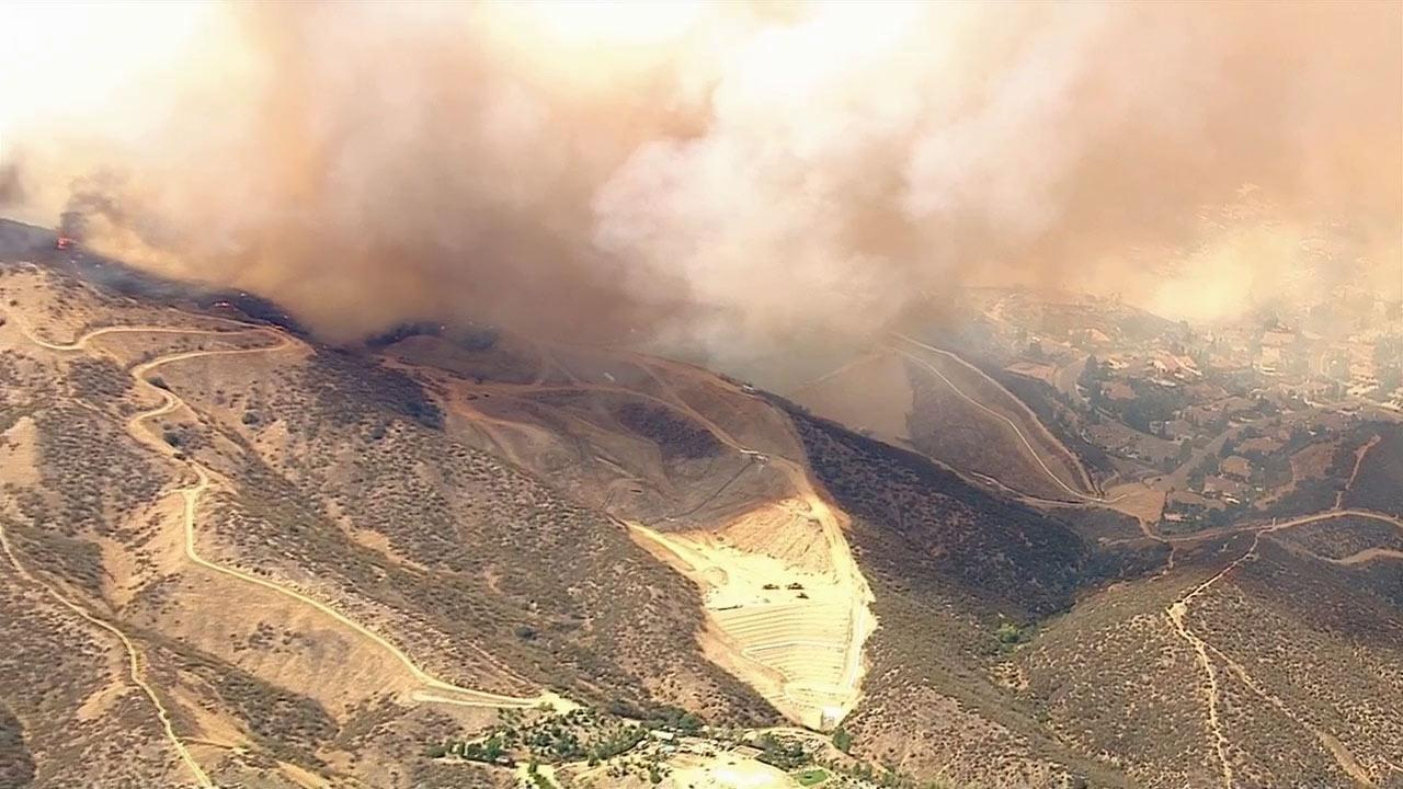 A brush fire erupted in San Bernardino County, quickly scorching more than 200 acres and forcing evacuations Friday, June 28, 2013.