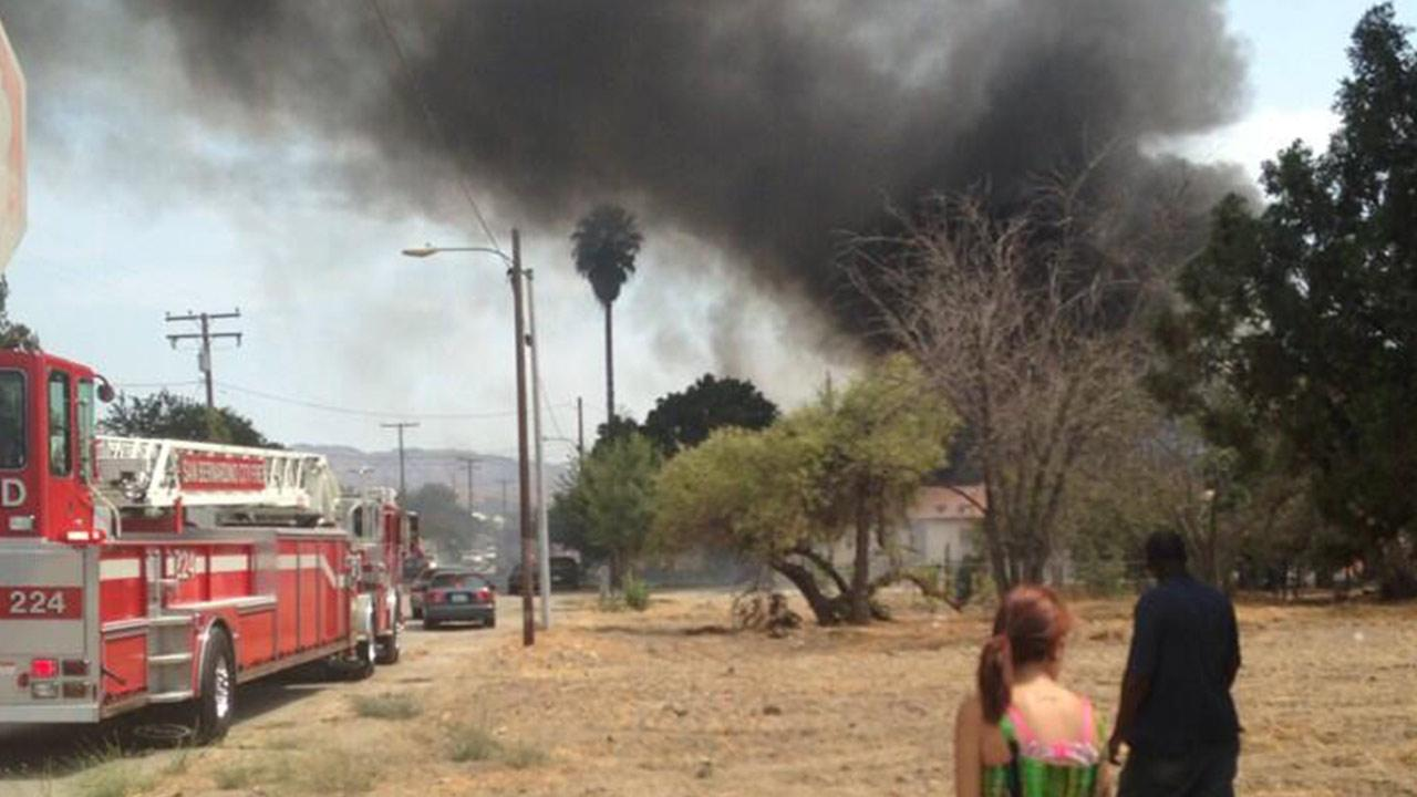 A brush fire is seen in San Bernardino in this photo sent by ABC7 viewer Tara Nichole via Twitter on Saturday, June 19, 2013.