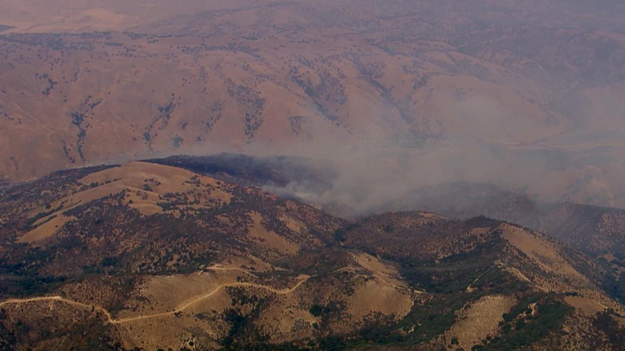 Firefighters were battling a fire near the southbound 5 Freeway and Fort Tejon in the Kern County town of Lebec on Friday, July 19, 2013.