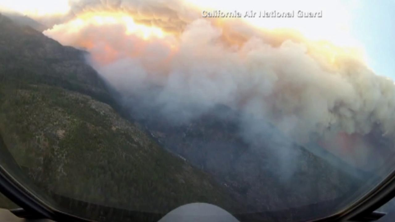 A California National Guard aircraft flies above the Rim Fire on Wednesday, Aug. 28, 2013.