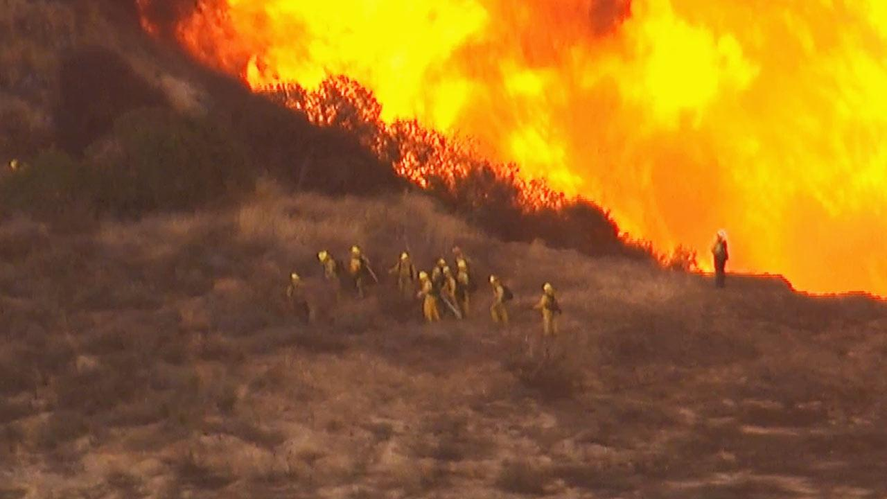 Brush fire burns in Angeles National Forest above Azusa