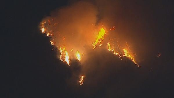 A brush fire is seen burning in the foothills above the Glendora and Azusa area on Thursday, Jan. 16, 2014.