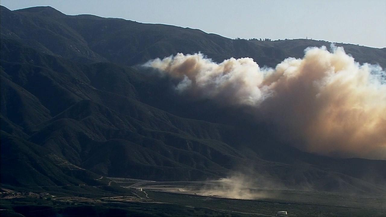 A brush fire erupted in Day Canyon under hot and windy conditions Wednesday, April 30, 2014.