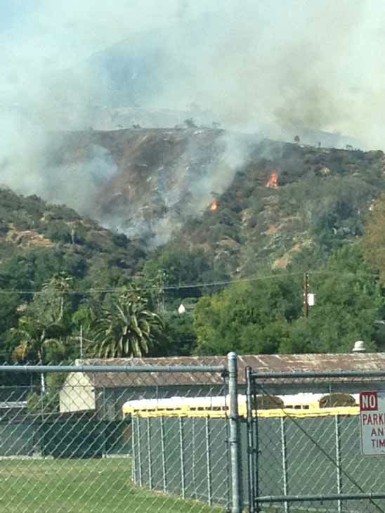 Firefighters responded to a brush fire in the area of Hillcrest Boulevard and Madison Avenue in Monrovia on Saturday, April 20, 2013.  <span class=meta>(KABC Photo)</span>
