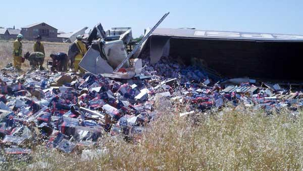 Pepsi truck overturns on SB HWY 99 after hit & run