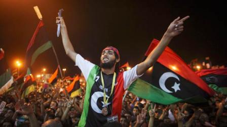 People celebrate the capture in Tripoli of Moammar Gadhafis son and one-time heir apparent, Seif al-Islam, at the rebel-held town of Benghazi, Libya, early Monday, Aug. 22, 2011.