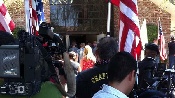 Television crews gather outside Myers Funeral Home.