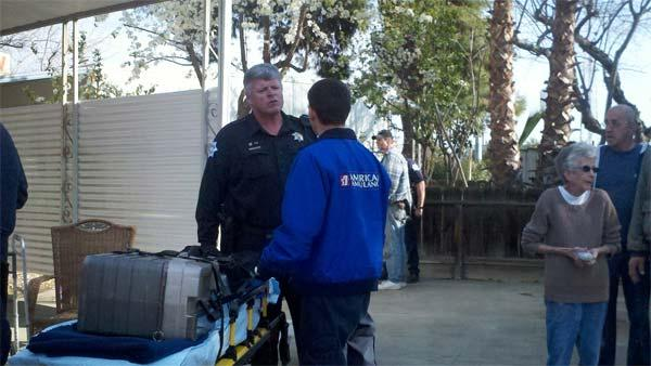 The Fresno PD officer who pulled a female victim out of a burning mobile home. He is c
