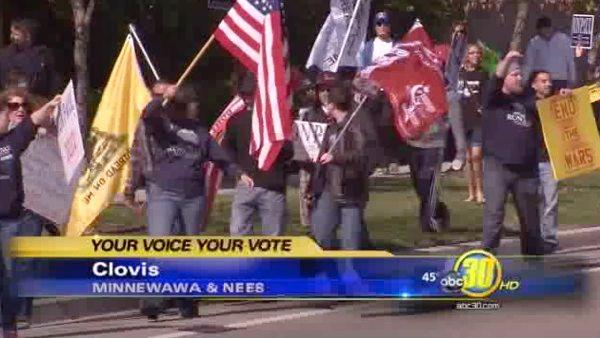 Dozens march in Clovis to show support for Ron Paul