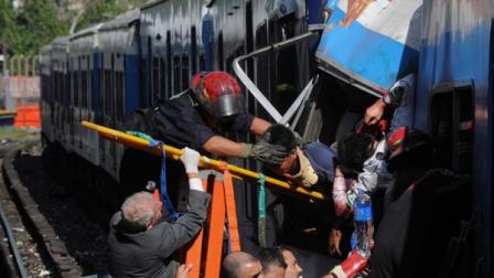 Firemen rescue wounded passengers from a commuter train after a collision in Buenos Aires, Argentina, Wednesday Feb. 22, 2012