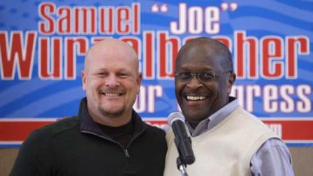 Former presidential candidate Herman Cain, right, joins Republican congressional candidate Samuel Wurzelbacher, better known as Joe the Plumber