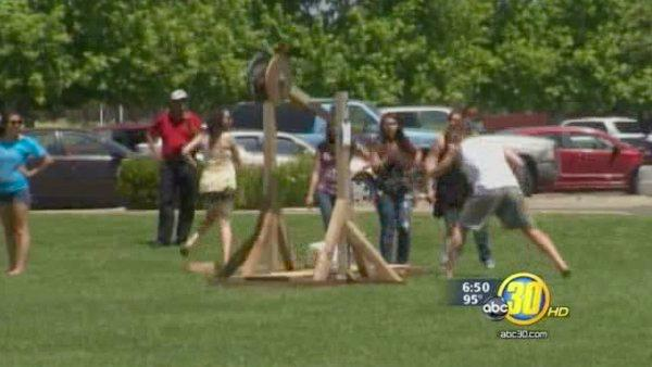 Merced College students demonstrate siege weapons