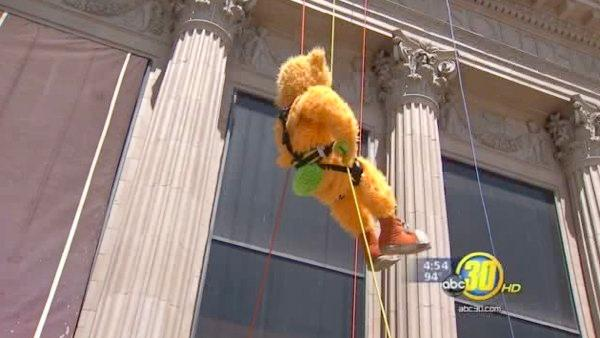 Fresno Police Chief, Grizzlies mascot rappel down landmark