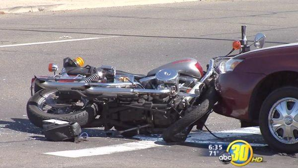 Funeral procession motorcyclist injured in crash