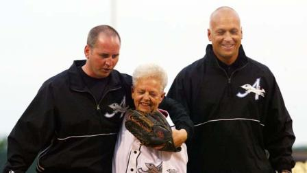 June 18, 2002 file photo shows Cal Ripken Jr., right, owner of the Aberdeen IronBirds, and his brother, Bill, walking off the field with their mother