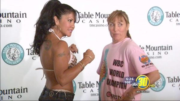 Mia St. John and Christy Martin face off in the ring