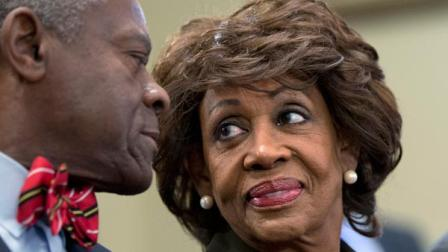 Rep. Maxine Waters, D-Calif., smiles at her husband, Sidney Williams