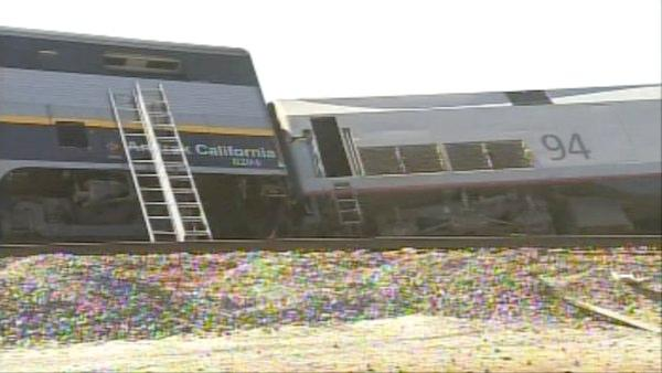 One train car has derailed and two other cars are at a 45 degree angle at 10th Avenue and Kansas Avenue in Hanford, according to the Kings County Fire Department.