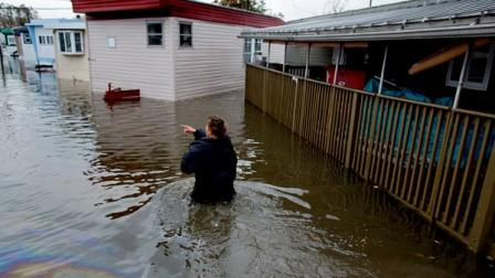 Andrea Grolon walks through waist-deep water in the Metropolitan Trailer Park in Moonachie, N.J. on Tuesday, Oct. 30, 2012.