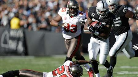 Oakland Raiders running back Darren McFadden (20) runs against the Tampa Bay Buccaneers during the first quarter of an NFL football game in Oakland, Calif., Sunday, Nov. 4, 2012.