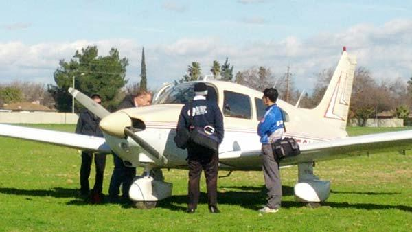 A small aircraft made an emergency landing in a field near Walnut Avenue and Church Avenue