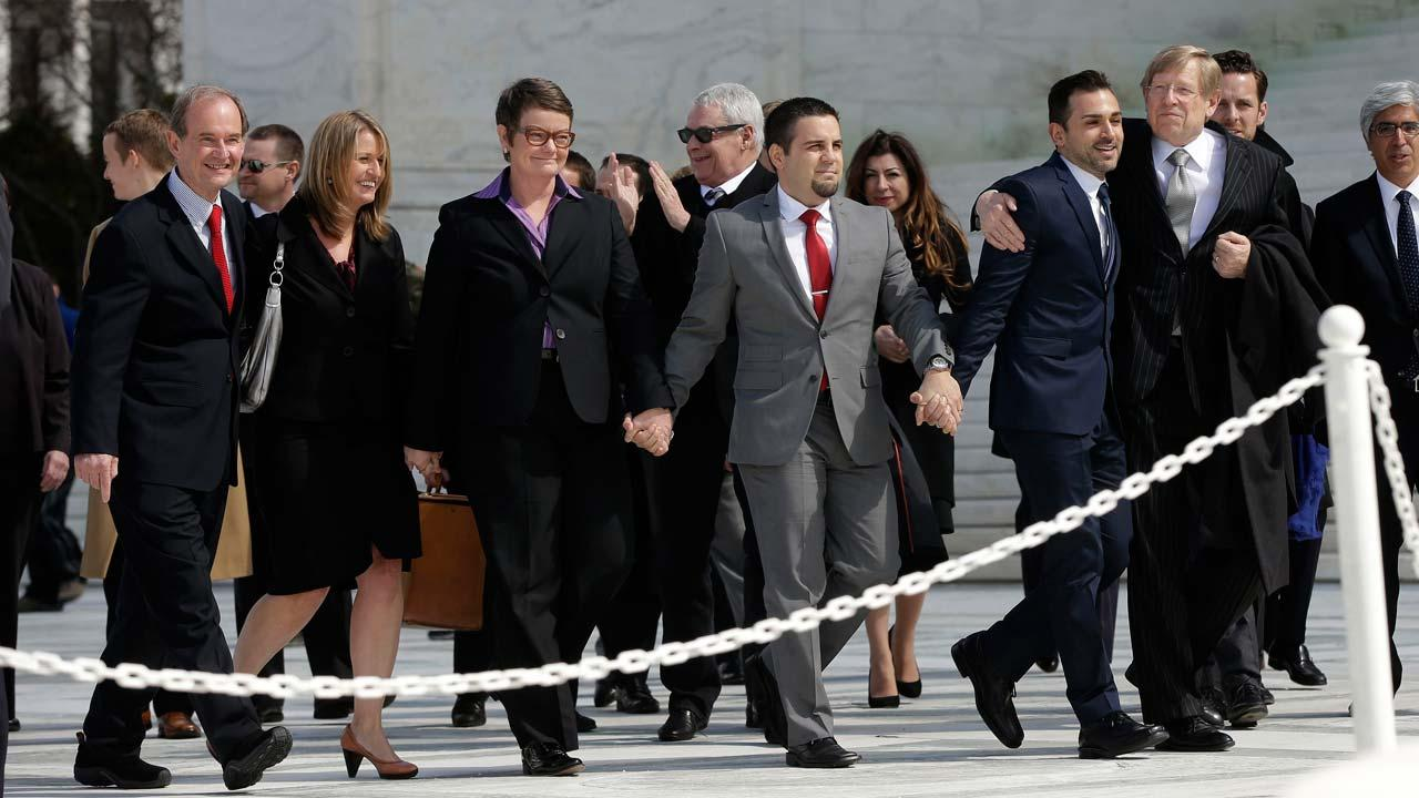 From left, attorney David Boies, plaintiffs, Sandy Stier, with partner Kris Perry, from Berkeley, Calif., Jeff Zarrillo, with partner Paul Katami from Burbank, Calif., and their attorney Theodore Olson leave the Supreme Court in Washington