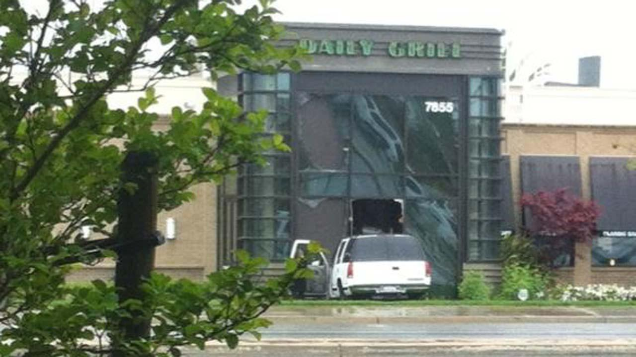 Chevrolet Tahoe crashed through the Daily Grill restaurant and knocked down three large windows