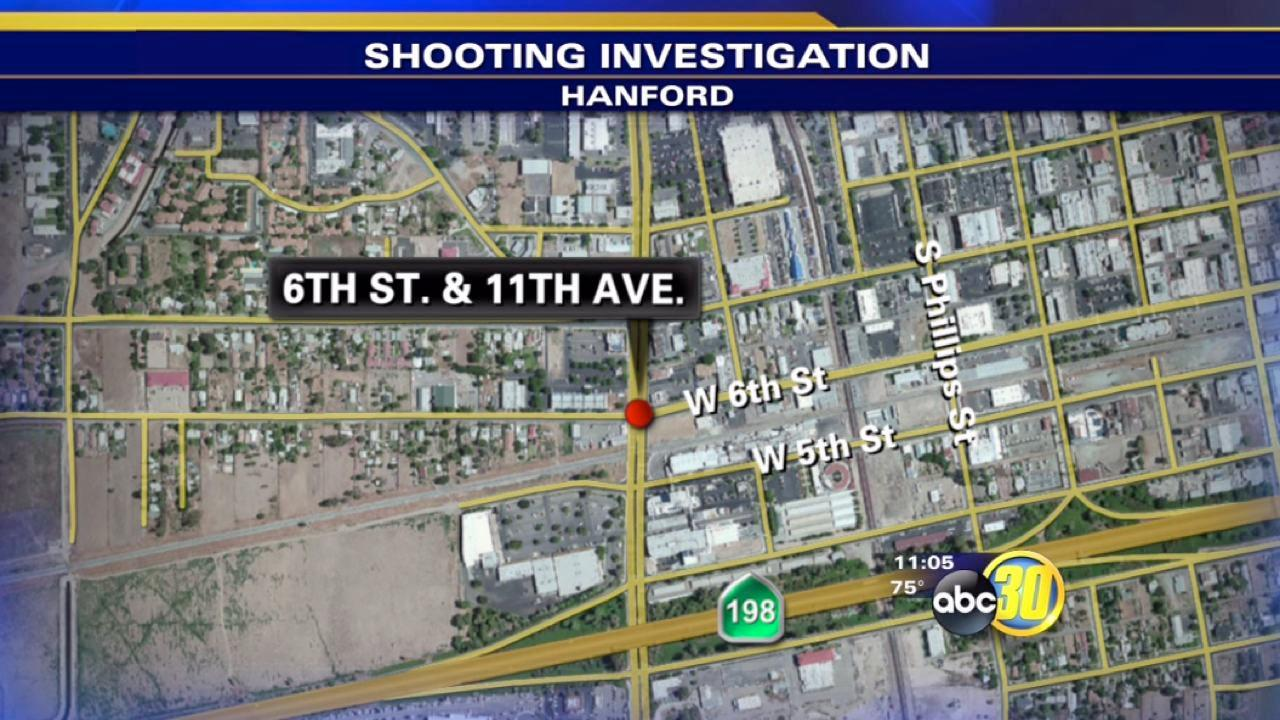 Hanford woman shot in her front yard
