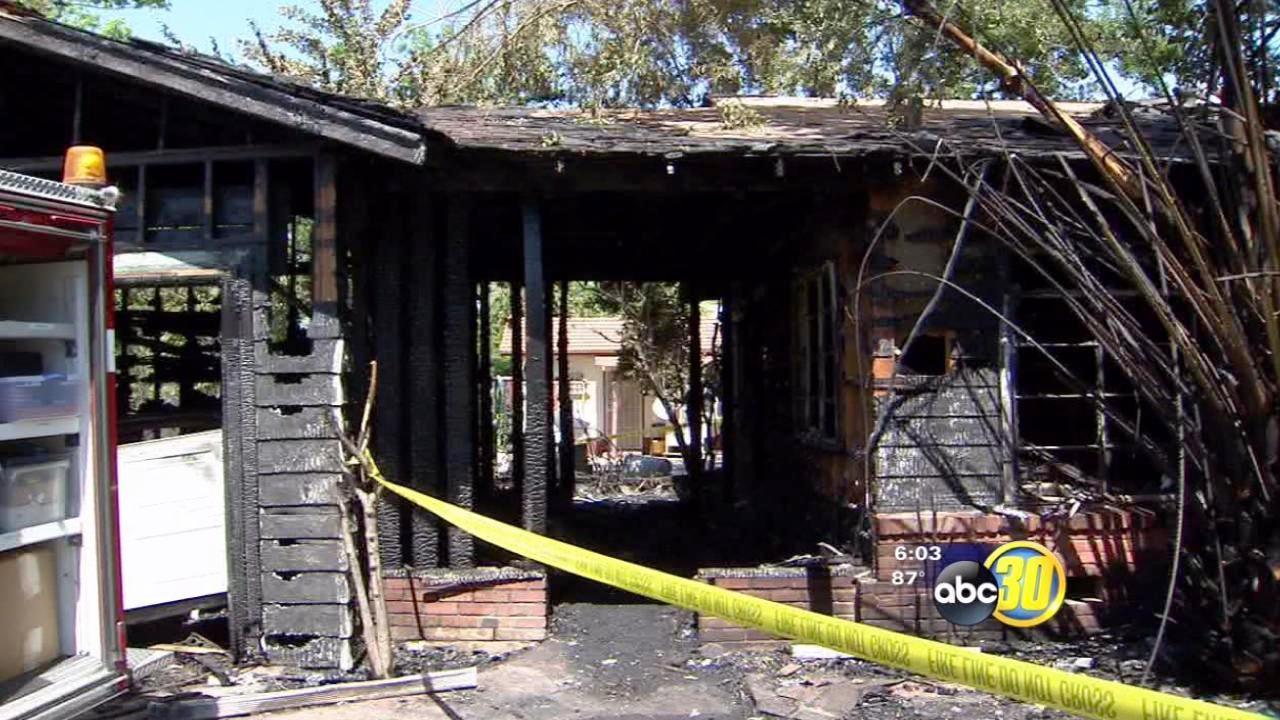 Investigators look into Merced house fire