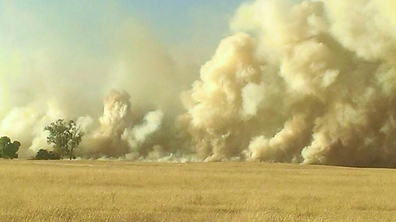 Rolling Fire in Madera County fire burning rapidly toward the cattle ranch