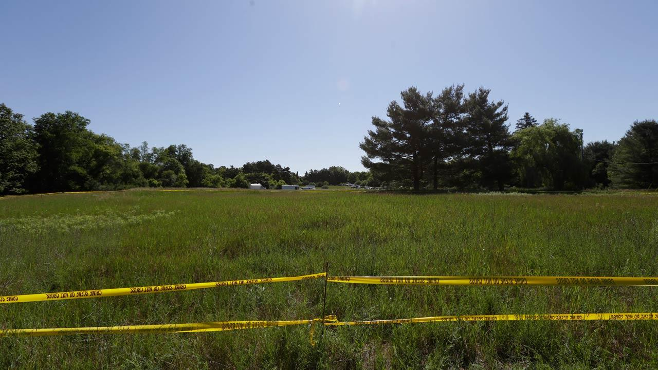 Crime scene tape surrounds the scene in Oakland Township, Mich., Monday, June 17, 2013 where officials search for the remains of Teamsters union president Jimmy Hoffa who disappeared from a Detroit-area restaurant in 1975.