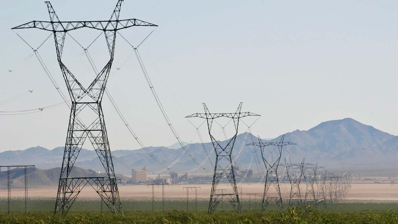 High-voltage power lines cross adjacent to the proposed location of three BrightSource Energy solar-energy generation complexes in the eastern Mojave Desert