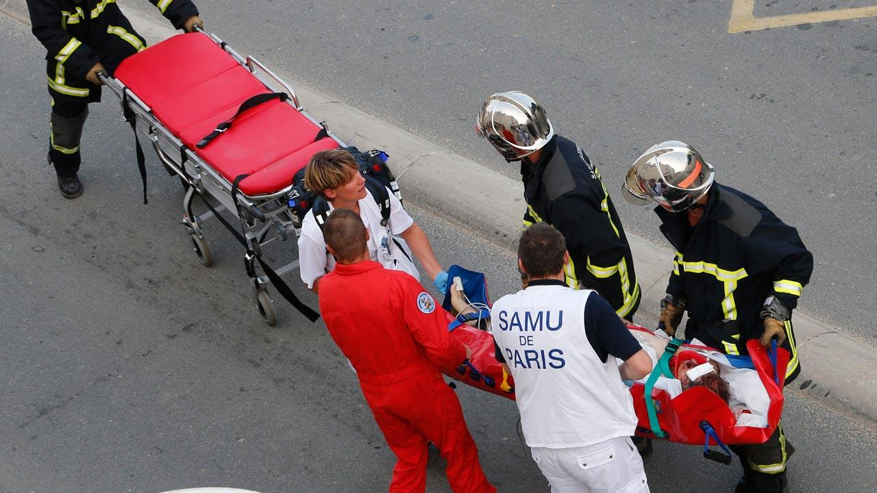 Rescue workers transport a victim from a train that derailed in Bretigny sur Orge, south of Paris, Friday July, 12, 2013.