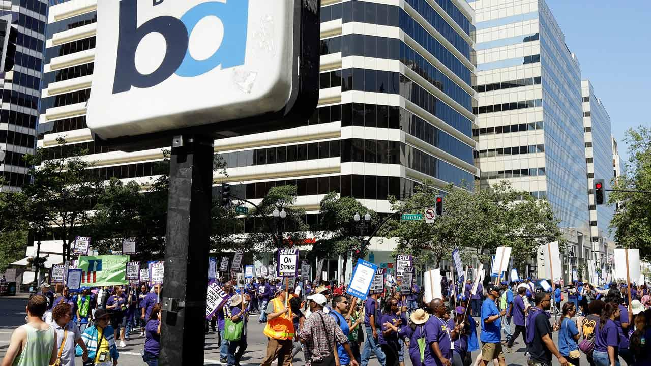 In this file photo from Monday, July 1, 2013, striking Bay Area Rapid Transit workers picket as they close the intersection of 14th and Broadway on Monday, July 1, 2013,